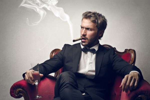 bearded-man-sitting-with-cigar-and-champagne-1024x682