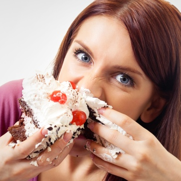 Woman eating pie